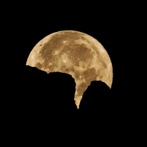 Full moon behind Horsetooth Rock